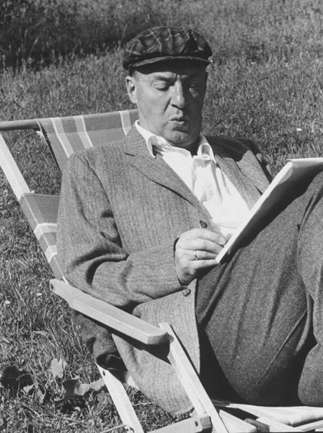 Vladimir Nabokov writing on paper in the garden. Source: Getty Images