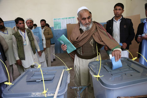 An Afghan man casts his vote at a polling station in Jalalabad, Afghanistan, Saturday, April 5, 2014. Source: AP