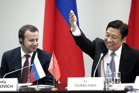 "Russia's deputy prime minister Arkady Dvorkovich (L), and Li Yuanchao, vice-president of the People's Republic of China, at a panel session titled ""Russia - China: Strategic Economic Partnership"" at the 2014 St Petersburg International Economic Forum (SPIEF). Source: Itar-Tass"
