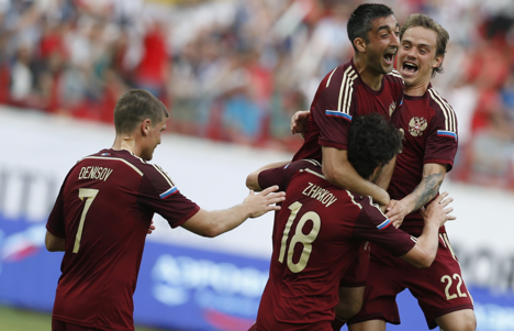 Members of Team Russia celebrating a goal against Morocco in a friendly match. Source: AP