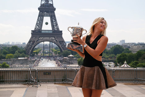 Maria Sharapova poses with her trophy near the Eiffel Tower in Paris a day after winning the women's singles final match during the French Open tennis tournament at the Roland Garros stadium in Paris, on June 8, 2014. Source: AP Source