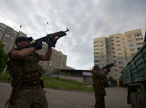 People's militia fighters during a battle with Ukraine's border guards in the Mirny neighborhood on the outskirts of Lugansk. Source: Evgeny Biyatov / RIA Novosti