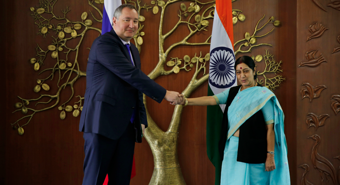 Russian Deputy Prime Minister Dmitry Rogozin and Indian Foreign Minister Sushma Swaraj, pose for the media before their meeting in New Delhi, June 18, 2014. Source: AP