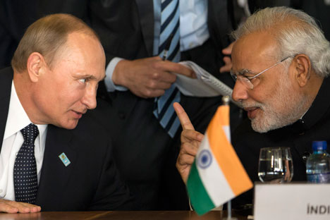 Narendra Modi and Vladimir Putin on the sidelines of the BRICS summit in July. Source: AP