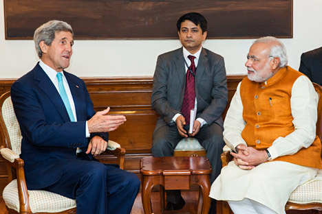 U.S. Secretary of State John Kerry speaks with Indian Prime Minister Narendra Modi at the latter's residence in New Delhi on August 1, 2014. Source: AP