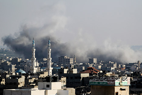 Smoke rise after an Israeli strike over Gaza City on August 8, 2014. Source: Photoshot