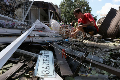 Ruined hopes: a bomb-damaged building in Donetsk, which has become a city under siege. Source: Reuters