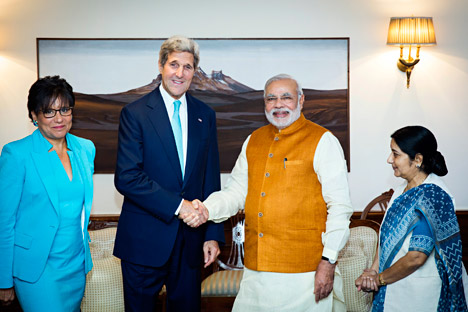 John Kerry shakes hands with Narendra Modi, as Indian Foreign Minister Sushma Swaraj, right, and U.S. Secretary of Commerce Penny Pritzker stand by their sides at Modi's residence in New Delhi on August 1, 2014. Source: AP