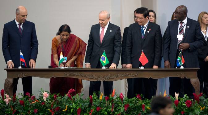 Officials from the BRICS countries sign the agreement to form a BRICS Bank. Source: AP