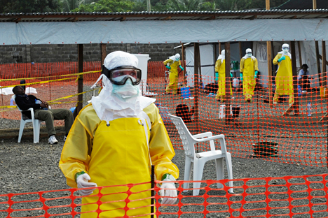 Medicins Sans Frontieres health workers prepare at ELWA's isolation camp during the visit of Senior United Nations System Coordinator for Ebola David Nabarro, at the camp in Monrovia August 23, 2014. As the outbreak has spread across borders from its initial epicentre in Guinea, governments in the region have introduced increasingly strict travel restrictions. Source: Reuters