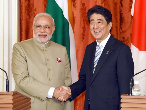 Shinzo Abe and Narendra Modi shake hands after a joint press conference at the state guest house in Tokyo on September 1, 2014. Source: Photoshot / Vostock Photo