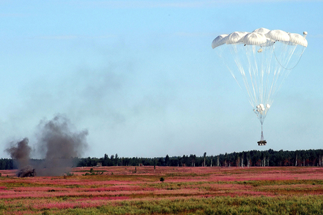 Airdrop of military equipment. Source: PhotoXPress