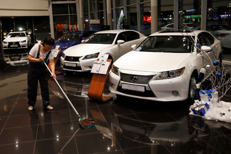 Currency crisis prompts halt in foreign car sales and freeze on new loans. Source: Reuters