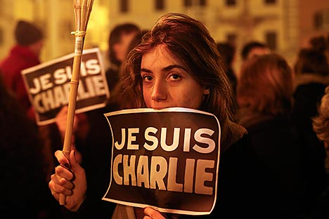 "A woman holds a placard reading ""I am Charlie"" to pay tribute to the victims following a shooting by gunmen at the offices of weekly newspaper Charlie Hebdo in Paris in front of the French embassy in Rome January 8, 2015. Source: Reuters"