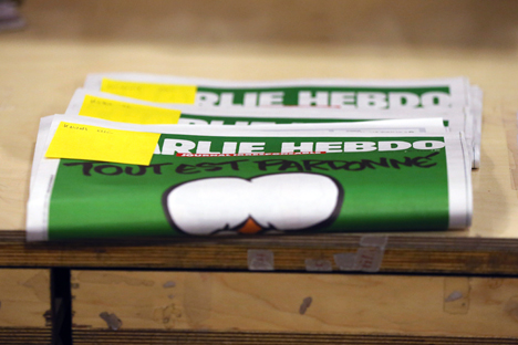 Reserved copies of the first edition of Charlie Hebdo published after the deadly attacks by Islamist gunmen in Paris last week, are pictured in a bookstore in Brussels January 15, 2015. Source: Reuters