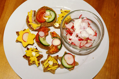 Salad with radishes and sour cream, sandwiches on toasted bread. Source: Anna Kharzeeva