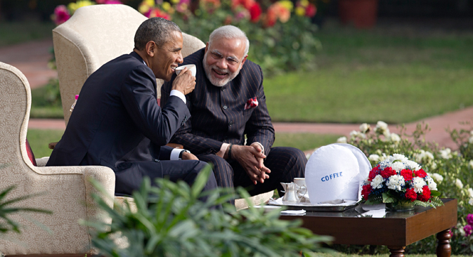 President Barack Obama and Indian Prime Minister Narendra Modi have coffee and tea in the gardens of the Hyderabad House in New Delhi on Jan. 25, 2015. Source: AP