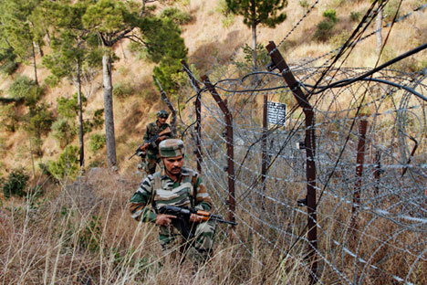 Indian army soldiers patrol near one of their forward posts at the Line of Control (LOC), that divides Kashmir between India and Pakistan. Source: AP