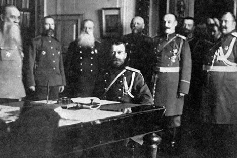 Emperor Nicholas II at a table with a group of Military Council members. Source: RIA Novosti