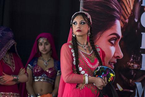 A young woman prepares to go on stage during the Holi Festival in Moscow. Source: Evgeny Biyatov / RIA Novosti
