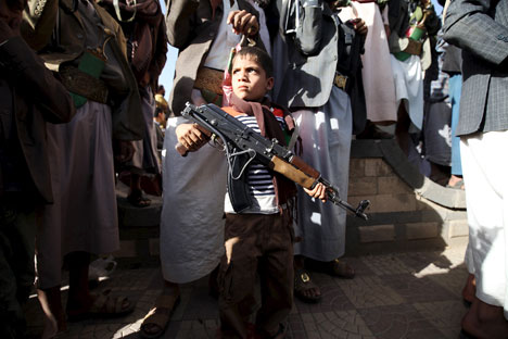 A boy stands among followers of the Houthi group during a demonstration against an arms embargo imposed by the U.N. Security Council on the group in Sanaa, on April 16. Source: Reuters