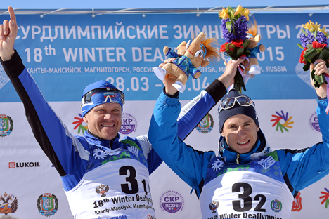 Sergei Yermilov(L) and Vladimir Mayorov gold winners of the men's cross-country team sprint at the XVIII Deaflympics in Khanty-Mansiysk, during the awarding ceremony. Source: Vladimir Astapkovich / RIA Novosti