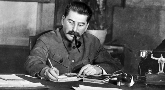 A reproduction photo of Joseph Stalin, General Secretary of the Central Committee of the All-Union Communist Party (Bolsheviks), in his office. Source: RIA Novosti