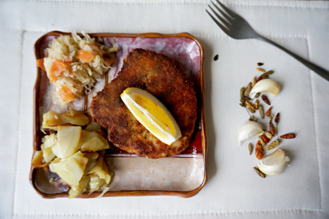 Pork schnitzel served with potatoes and pickled cabbage. Source: Anna Kharzeeva