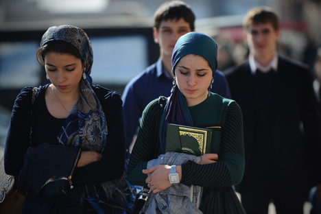 Young women seen near the Berkat market in Grozny, Chechnya, 2012. Source: Ramil Sitdikov / RIA Novosti