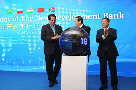 China, Shanghai : (From left) K.V. Kamath, president of the New Development Bank, Chinese Finance Minister Lou Jiwei and Shanghai Mayor Yang Xiong attend the opening ceremony of the New Development Bank in Shanghai, China, 21 July 2015. Source: AFP/East News