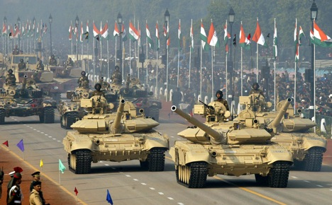 Indian Army battle tanks T-90, foreground, and T-72, background, go past the saluting base during the 54th Republic Day Parade. Source: AP