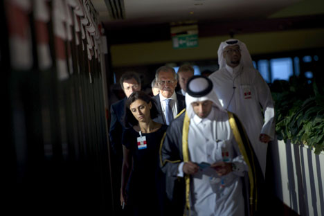 Russia's Foreign Minister Sergey Lavrov (C) walks with others before a trilateral meeting in Doha, Qatar August 3, 2015. Source: Reuters