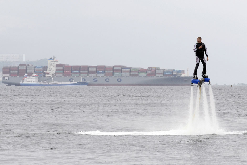 A participant rides a flyboard during a performance, part of a local cultural and sports festival, in the far eastern port of Vladivostok, RussiaCredit: Reuters