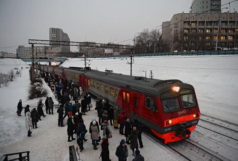 A suburban train at a railway station.