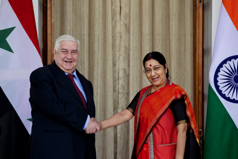 Syrian Deputy Prime Minister and Foreign Minister Walid Al Moualem, left, shakes hands with Indian External Affairs Minister Sushma Swaraj in New Delhi, India, Tuesday, Jan. 12, 2016.