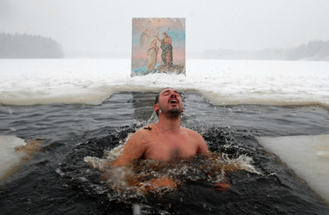 A man bathing on the Orthodox Epiphany day.