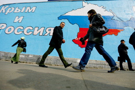 A mural showing the Crimean peninsula in Russian national colours on the wall of a building in Moscow's Taganskaya Square. The message reads: Crimea and Russia are united forever! March 31, 2014.