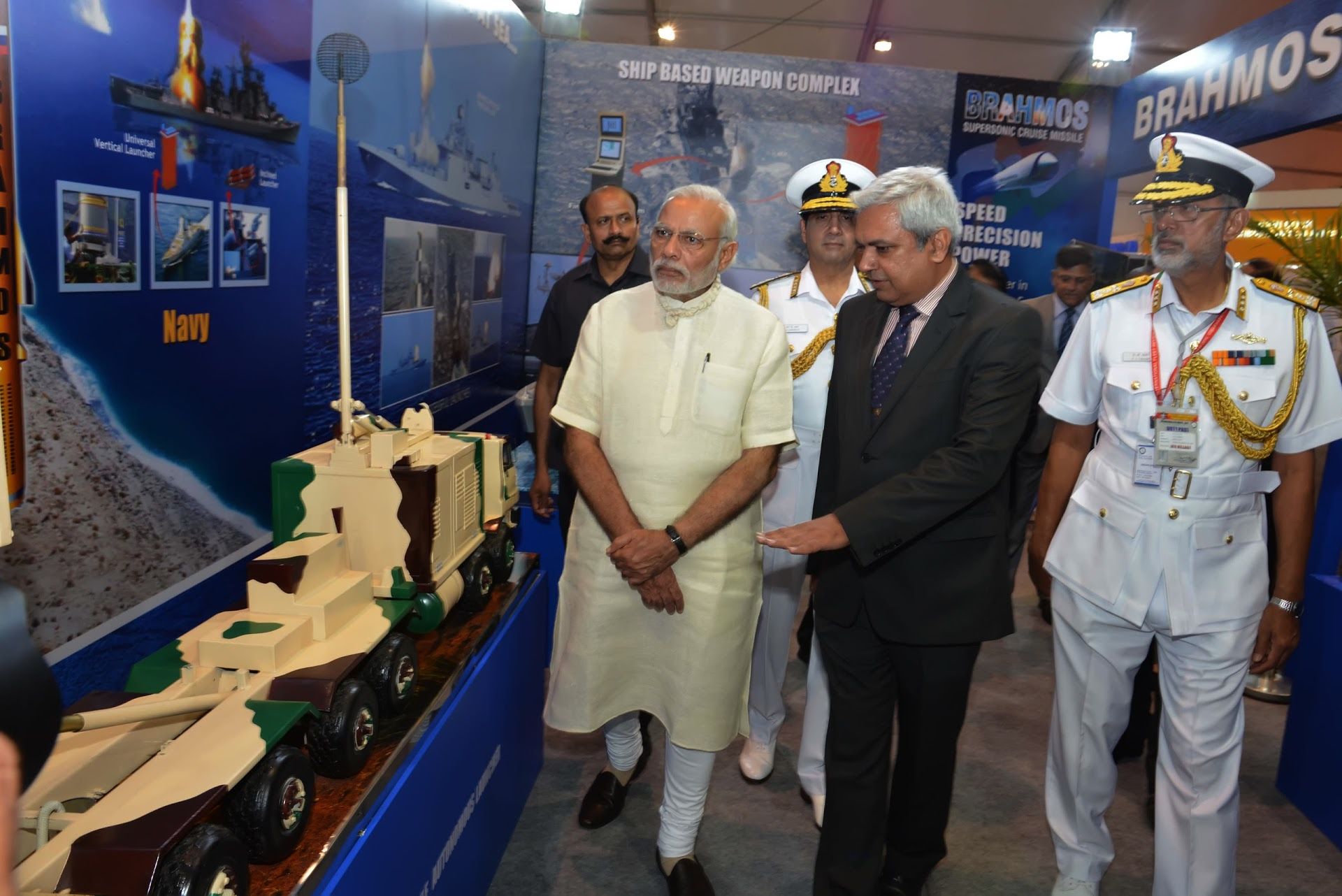 Narendra Modi was briefed about the BrahMos supersonic cruise missile system by Cdr. Ashotoosh Mehra (C).