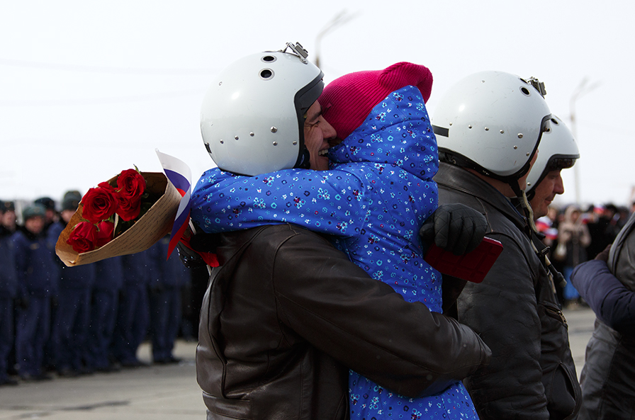 A Russian pilot receives a welcome on returning from Syria at an airbase near the Russian city of Voronezh, March 15, 2016.