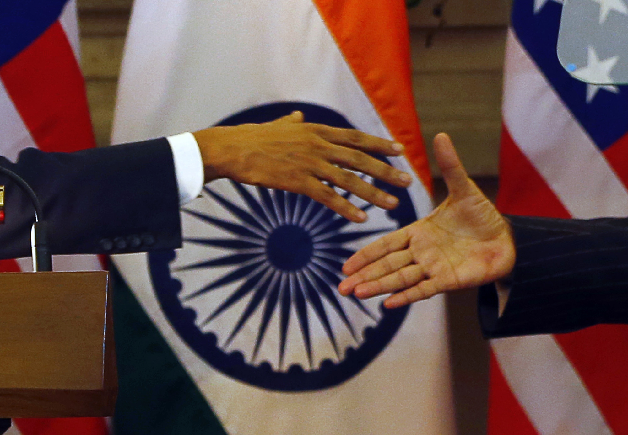 U.S. President Barack Obama, left and Indian Prime Minister Narendra Modi prepare to shake their hands after they jointly addressed the media after their talks, in New Delhi, India, Sunday, Jan. 25, 2015.