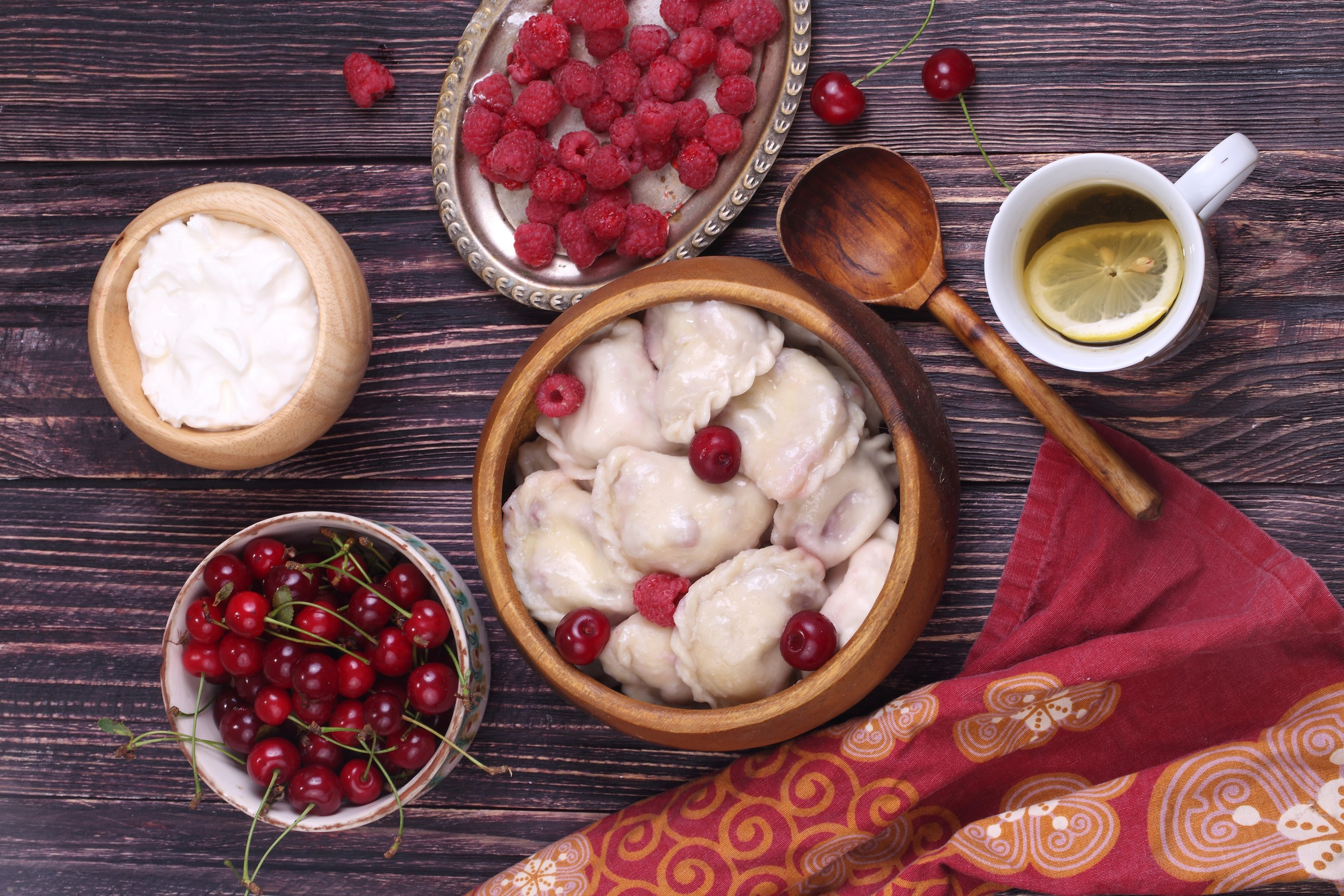 Sweet cherry dumplings (vareniki) with Vladimir cherries, raspberry and sour cream.