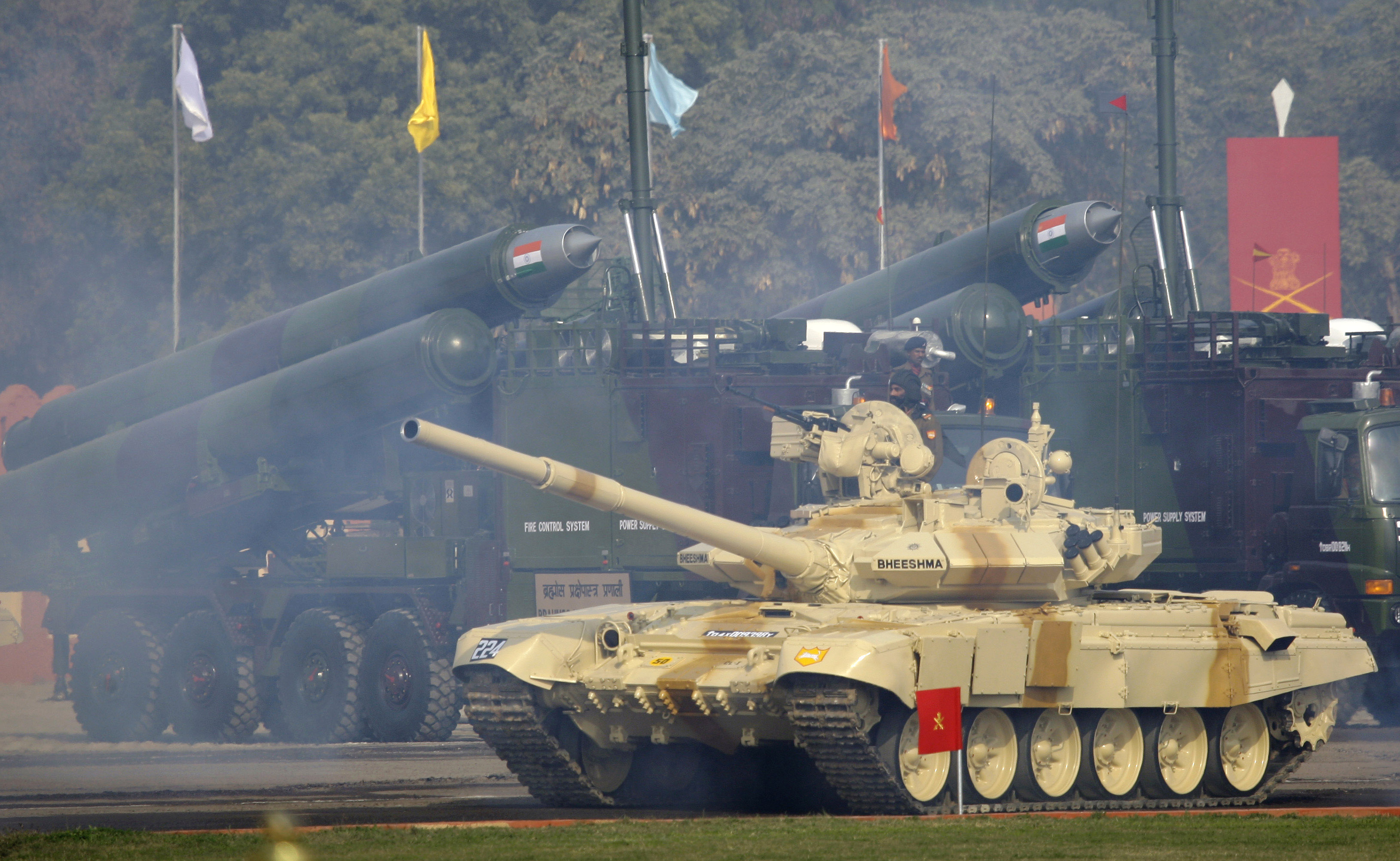 An Indian Army Bhishma tank, the locally assembled version of the T-90 S tank, rolls in front of vehicle mounted Brahmos missiles during Army Day parade in New Delhi, 2009.