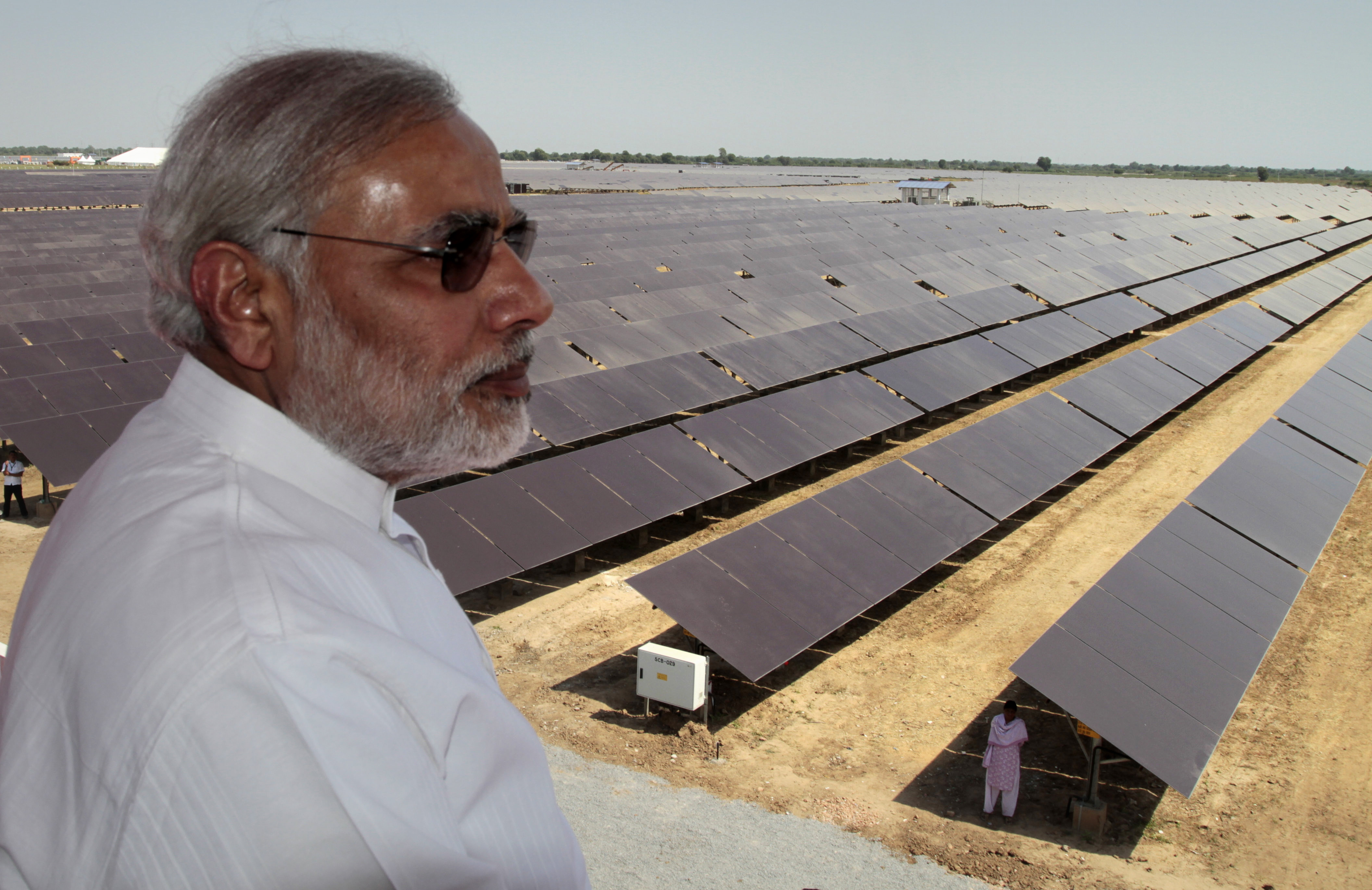 Narendra Modi overlooks the panels at a solar energy farm at Gunthawada in Gujarat state in 2011.