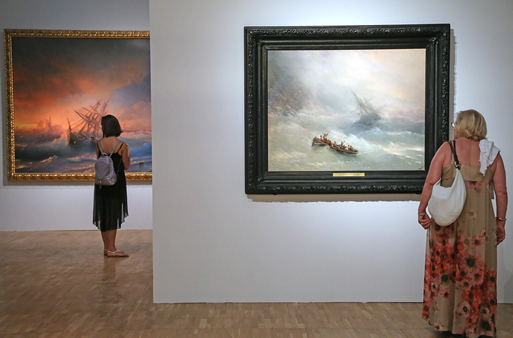 """The Rainbow, 1873.Following in the tradition established by Théodore Géricault in his painting """"The Deluge"""", Aivazovsky the Romantic held a particular passion for scenes of great storms and shipwrecks. The protagonists are generally depicted with no superfluous detail, allowing the sea to stand out in all its threatening majesty. Having received the very best tuition at the Imperial Academy of Arts, Aivazovsky came to demonstrate great mastery of the art of painting. This is evident here in the sky's highly subtle tonal shifts and the scarcely perceptible rainbow, which serves to give hope of salvation to the drowning."""