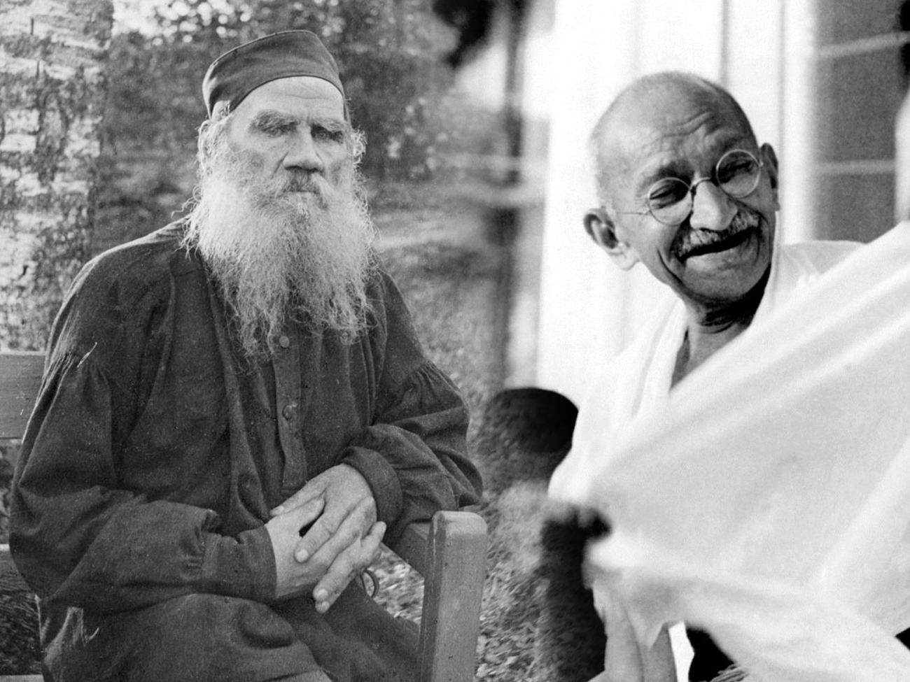 A collage of Leo Tolstoy and Mahatma Gandhi.