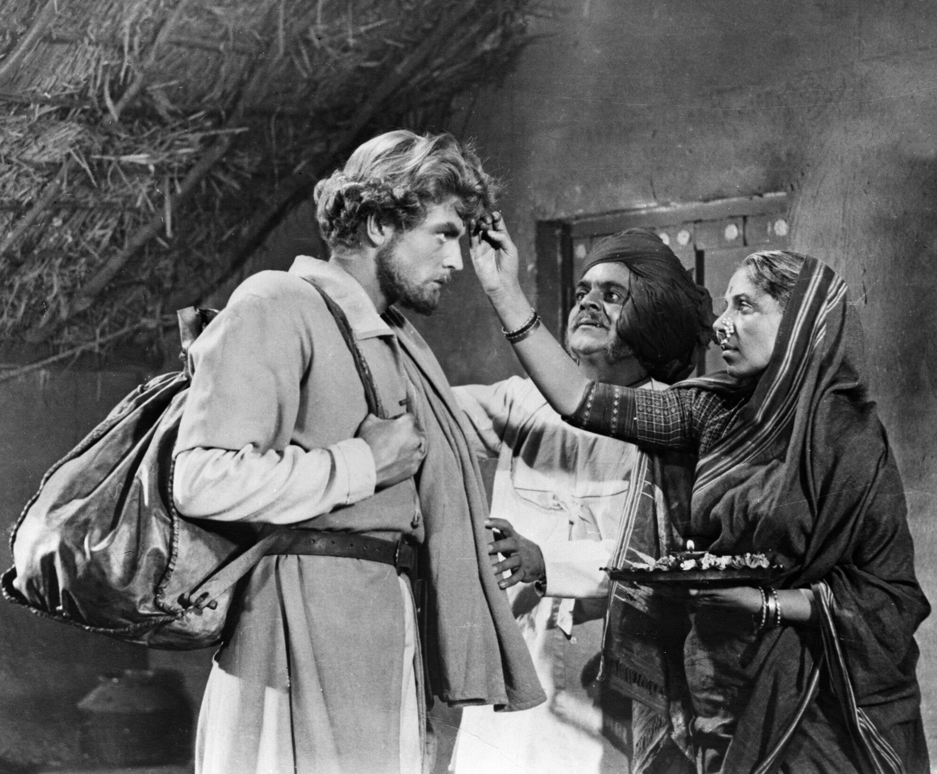 "Soviet actor Oleg Strizhenov as Afanasiy Nikitin (left) and Indian actors at the shooting of the first Soviet-Indian movie ""Over Three Seas""."