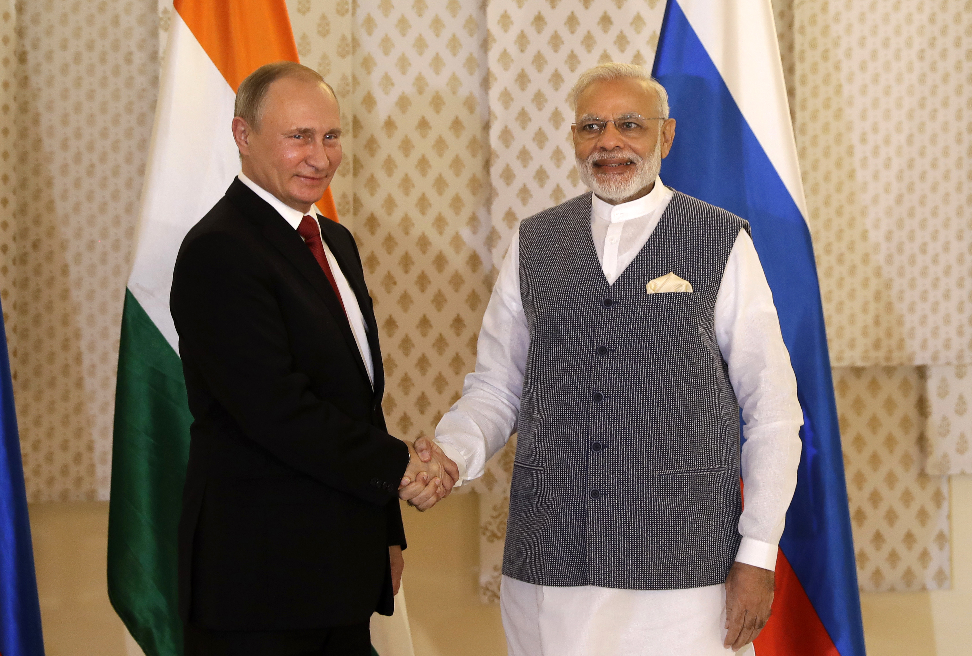 Indian Prime Minister Narendra Modi shakes hand with Russian President Vladimir Putin prior to their annual bilateral meeting, on the sidelines of the BRICS summit, in Goa, Oct. 15, 2016.