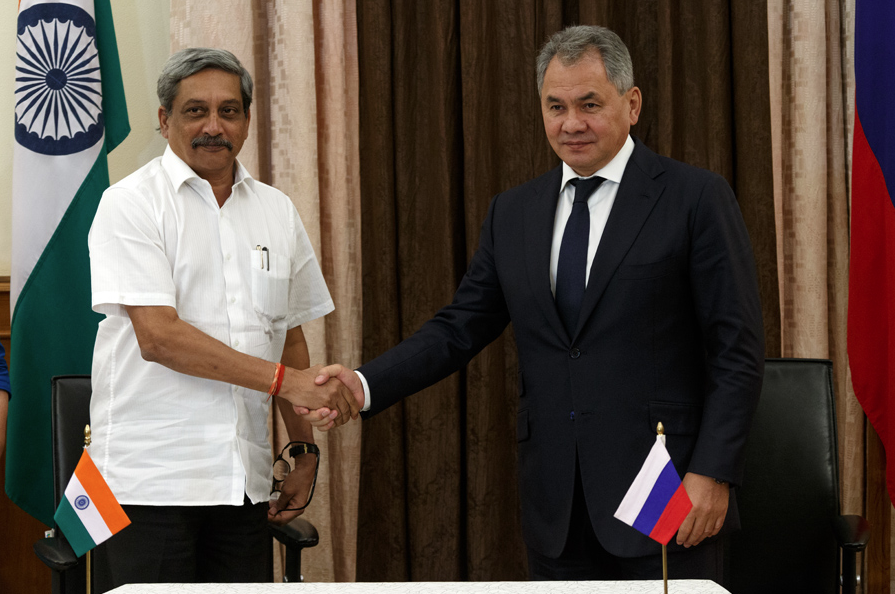 Defense Minister Sergei Shoigu, right, and Defense Minister of India Manohar Parrikar at a ceremony of signing a final protocol of the meeting of the Russian-Indian Inter-Governmental Commission on Cooperation in Military Industry, in Delhi.