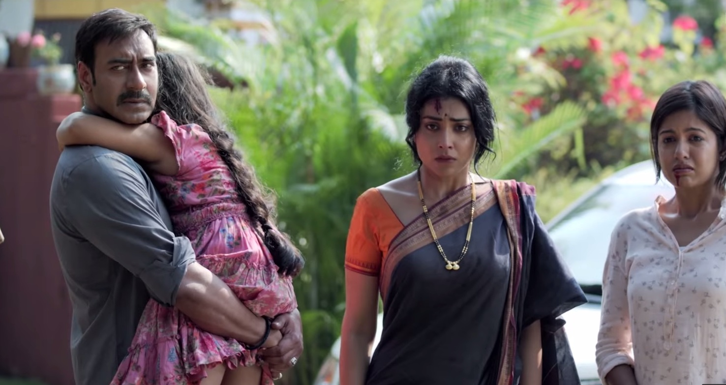 Ajay Devgn and Shriya Saran in Drishyam (2015).