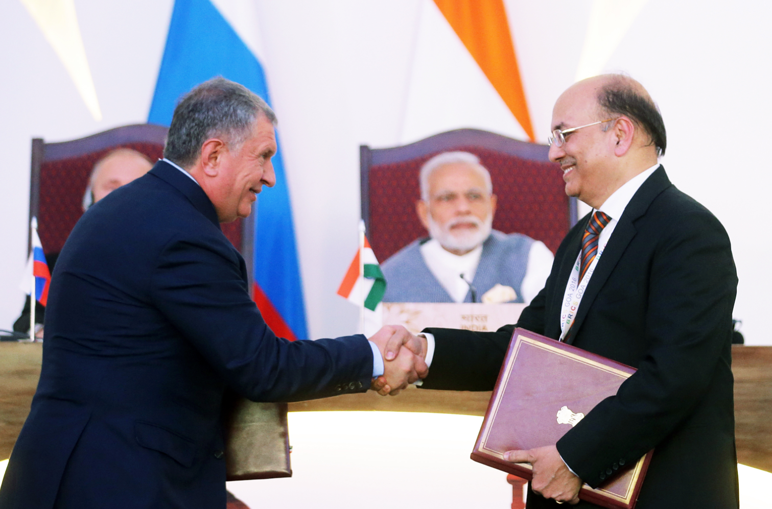 Rosneft oil company CEO Igor Sechin, left, and Narendra Verma, Managing Director of ONGC Videsh Limited, at the ceremony of signing documents attended by Russian President Vladimir Putin and Indian Prime Minister Narendra Modi in Goa, India, Oct. 15, 2016.